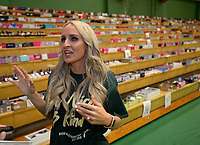 NWA Democrat-Gazette/ANDY SHUPE<br /> Carrie Jernigan speaks Saturday, Aug. 10, 2019, during the River Valley Kick Start at Alma Middle School. Inspired by her daughter, Harper, Jernigan bought all 1,500 pairs of shoes from a closing Payless Shoe Source in Fort Smith. Her effort national publicity and thousands of dollars in donations, which she used to buy more shoes and school supplies for kids going back to school.