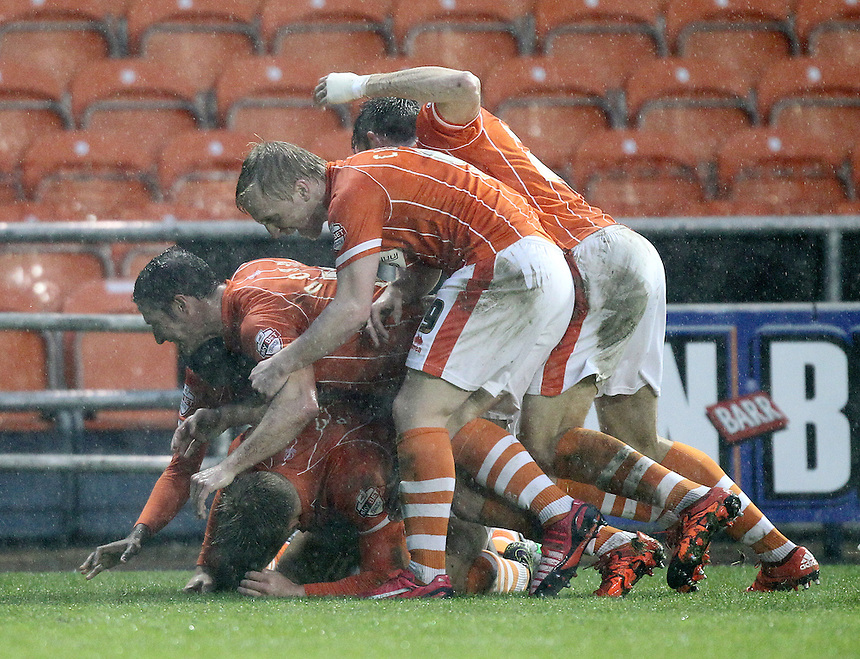 Blackpool's Brad Potts celebrates scoring his sides second goal <br /> <br /> Photographer Mick Walker/CameraSport<br /> <br /> Football - The Football League Sky Bet League One - Blackpool v Peterborough United - Saturday 19th December 2015 -    Bloomfield Road - Blackpool<br /> <br /> &copy; CameraSport - 43 Linden Ave. Countesthorpe. Leicester. England. LE8 5PG - Tel: +44 (0) 116 277 4147 - admin@camerasport.com - www.camerasport.com