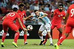 Paulo Dybala of Argentina (C) fights for the ball with Shakir Hamza of Singapore (L) during the International Test match between Argentina and Singapore at National Stadium on June 13, 2017 in Singapore. Photo by Marcio Rodrigo Machado / Power Sport Images