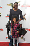 UNIVERSAL CITY, CA. - March 21: Actor Wayne Brady and daughter Maile arrive at the premiere of ''How To Train Your Dragon'' at Gibson Amphitheater on March 21, 2010 in Universal City, California.
