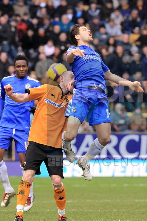 Wolverhampton Wanderers's David Jones amd Chelsea's Joe Cole tussle for the ball