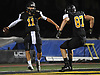 Gregory Campisi #11, St. Anthony's quarterback, left, gets congratulated by Conor Ryan #87 after scrambling 36 yards for a touchdown in a CHSFL varsity game against Monsignor Farrell at St. Anthony's High School in South Huntingon on Friday, Sept. 29, 2017.