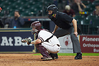 Mississippi State Bulldogs catcher Dustin Skelton (8) sets a target as home plate umpire Matt McKendry looks on during the game against the Houston Cougars in game six of the 2018 Shriners Hospitals for Children College Classic at Minute Maid Park on March 3, 2018 in Houston, Texas. The Bulldogs defeated the Cougars 3-2 in 12 innings. (Brian Westerholt/Four Seam Images)