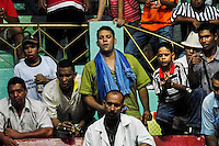 Colombian spectators watch a highly emotional cockfight in the arena in Santa Marta, Colombia, 20 May 2006. Cockfight is a widely popular and legal sporting event in much of Latin America. People take advantage of cock's natural, strong will to fight against all males of the same species. Birds are specially bred to increase their aggression and stamina, they are given the best of food and care. The cocks are equipped with tortoise-shell made gaffs tied to the bird's leg. The fight is not intentionally to the death but it may result in the death of cocks very often because birds never stop fighting till they are dead.