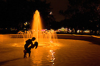 Tango dancers Paul Vladimirsky, left, and Cassandra Kagiyama, of Phoenix, tango in a fountain at Denver's Cheesman Park during the 7th Annual Denver Memorial Day Tango Festival, Sunday, May 27, 2007. The Arizona State University students stepped into the pool to comfort feet tired from several nights of dancing at the festival. (Kevin Moloney for the New York Times) <br /> LAB: Lights are yellow/orange. Please don't correct. Subjects should be in silhouette. Please don't excessively lighten. Thanks.<br /> <br /> Paul Vladimirsky:<br /> pablovl@hotmail.com<br /> 480-544-0302<br /> <br /> Cassandra Kagiyama:<br /> casskag@yahoo.com<br /> 480-586-7874