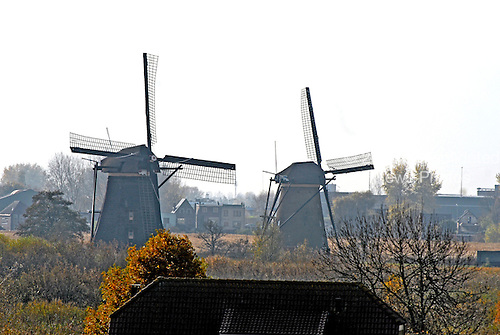 Rotterdam, Netherlands - November 6, 2007 -- 2 windmills on a farm along the Rhine River in the Netherlands between Rotterdam and Schoonhoven during the early afternoon on Monday, November 5, 2007..Credit: Ron Sachs / CNP