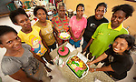 """RARE organized a dessert contest in Lobo Village, an event enthusiastically attended by village women. Quizzes on no take zones and an activity demonstrating the """"Tragedy of the Commons"""" phenomenon were incoroporated into the event."""