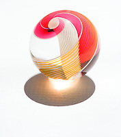 Colorful red, yellow and white glass marble