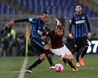 Calcio, Serie A: Roma vs Inter. Roma, stadio Olimpico, 19 marzo 2016.<br /> FC Inter&rsquo;s Jonathan Biabiany, left and Roma&rsquo;s Lucas Digne fight for the ball during the Italian Serie A football match between Roma and FC Inter at Rome's Olympic stadium, 19 March 2016. The game ended 1-1.<br /> UPDATE IMAGES PRESS/Isabella Bonotto