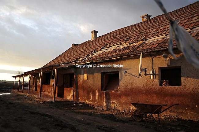 A condemned home is seen in the wake of an industrial accident caused by the rupture in a toxic sludge alumina reservoir at a nearby plant in Devecser, Hungary on November 24, 2010. On October 4, 2010 an industrial plant at the MAL plant in nearby Ajka, Hungary sent a torrent of hazardous material gushing through Devecser and surrounding villages, killing ten, injuring hundreds, and leaving several families homeless.