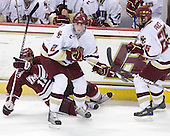 Chris Davis (UMass - 11), Brian Dumoulin (BC - 2), Matt Price (BC - 25) - The Boston College Eagles defeated the University of Massachusetts-Amherst Minutemen 2-1 (OT) on Friday, February 26, 2010, at Conte Forum in Chestnut Hill, Massachusetts.