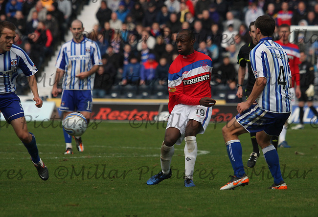 Sone Aluko (centre) plays the ball in the Kilmarnock v Rangers Clydesdale Bank Scottish Premier League match played at Rugby Park, Kilmarnock on 27.11.11