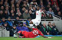 Serge Aurier of Spurs is tackled by David Alaba of Bayern Munich during the UEFA Champions League group match between Tottenham Hotspur and Bayern Munich at Wembley Stadium, London, England on 1 October 2019. Photo by Andy Rowland.