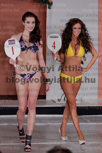 Nora Keseru (L) and Mira Hermansky (R) participate the Miss Hungary beauty contest held in Budapest, Hungary on December 29, 2011. ATTILA VOLGYI
