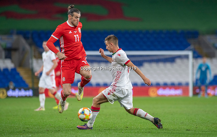 Cardiff - UK - 9th September :<br />Wales v Belarus Friendly match at Cardiff City Stadium.<br />Gareth Bale of Wales jumps over Ivan Bakhar of Belarus to retain control of the ball.<br />Editorial use only