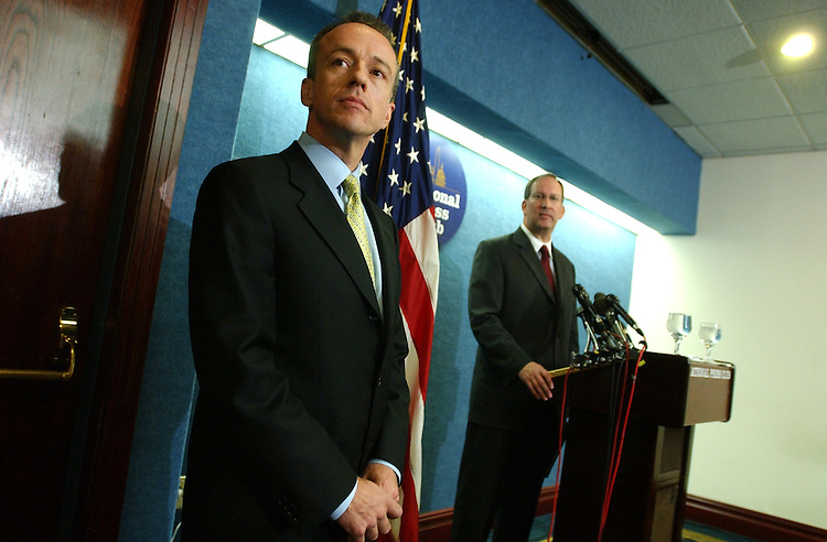 John Colyandro, left, and Jim Ellis, attend a news conference at the National Press Club.  Both are associates of Rep. Tom Delay, R-Texas, and read statements declaring innocence of criminal charges brought against them and Delay, in Texas.