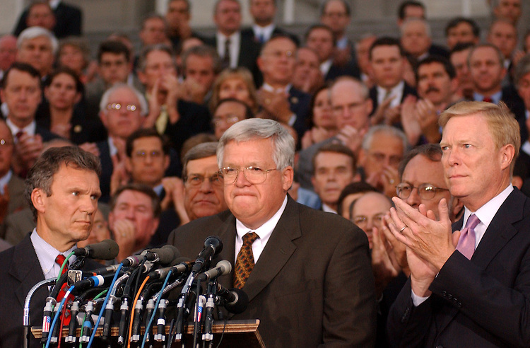 Hastert091101 -- From left, Sens. Tom Dashle, D-S.D., Trent Lott, R-Miss., Speaker Dennis Hastert, R-Ill., Rep. Dave Bonior, D-Mich., Rep. Dick Gephardt, D-Mo., appear with members of the House and Senate gathered on the East Front Steps of the Captiol to speak about the events of the day.