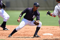 GCL Yankees 1 second baseman Bryan Cuevas (67) tags out a base runner during the first game of a doubleheader against the GCL Braves on July 1, 2014 at the Yankees Minor League Complex in Tampa, Florida.  GCL Yankees 1 defeated the GCL Braves 7-1.  (Mike Janes/Four Seam Images)