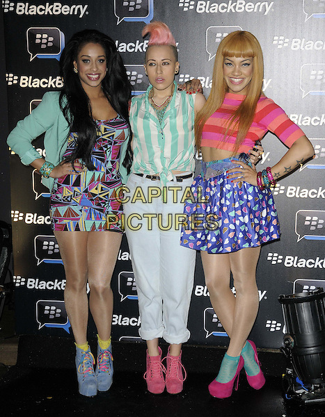 Stooshe.Blackberry BBM Party, Bankside Vaults, London, England..April 3rd 2012.full length band group Karls Anderson, Courtney Rumbold, Alexandra Buggs green white blue black pink print shorts trousers top blouse jacket shirt hand on hip.CAP/CAN.©Can Nguyen/Capital Pictures.