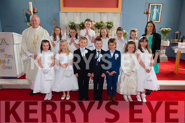 Pupils from St Finians NS Waterville who made their First Holy Communion in Dt Finians Church on Saturday pictured here front l-r; Clíonadh O'Shea, Clodagh Dwyer, Dylan Fitzgerald, Marcus Draper, James Galvin, Aoife Cronin, Sarah Murphy, back l-r; Fr. John Keirn, Aoibhinn Walsh, Sophie O'Sullivan, Catherine O'Connell, Lucy Higgins, Emma Foran, Lauren Fitzgerald & Niamh McCarthy(teacher).