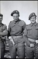 BNPS.co.uk (01202 558833)<br /> Pic: Bellmans/BNPS<br /> <br /> Three tough guys... Lance Corporal William James Cooke (middle).<br /> <br /> A fascinating trove of SAS records including some of the first photographs of the elite force which have never been seen before has been unearthed. <br /> <br /> The extensive assortment, also including medals and documents, was accumulated by war hero Lance Corporal William James Cooke at the end of World War Two. <br /> <br /> Remarkable images of Cooke's previously unrevealed wartime exploits show him serving behind enemy lines in occupied France and assisting with the liberation of Norway. <br /> <br /> His accomplishments have come to light after a family member presented the bequeathed collection to Hampshire-based auctioneer Bellmans, which will sell it tomorrow.