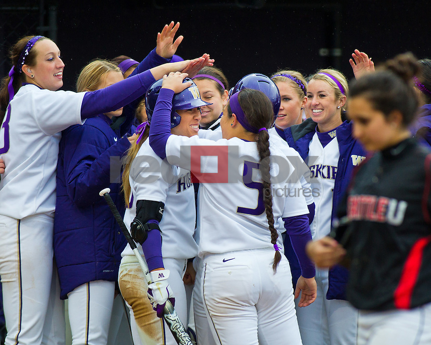 Kaitlin Inglesby, Whitney Jones, team celebrates..--------Washington Huskies softball team versus Seattle University at UW on Saturday, March 10, 2012. (Photo by Dan DeLong/Red Box Pictures)