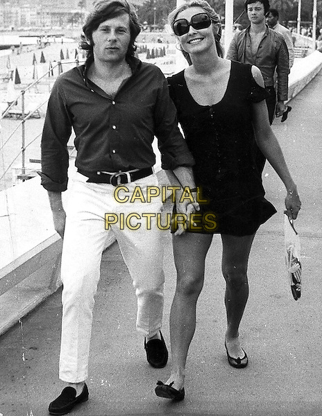 ROMAN POLANSKI & SHARON TATE.full length married husband wife holding hands black white dress sunglasses shades .CAP/PPG/GRA.©Graziani/People Picture/Capital Pictures