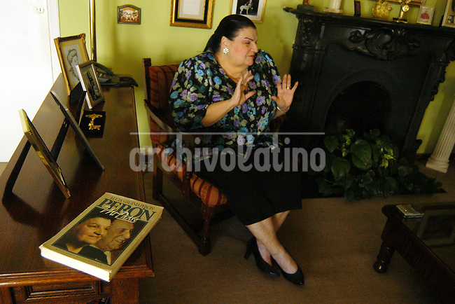 Lucia Virginia Holgado, quien reclama judicialmente que se la reconozca como hija del lider del peronismo Juan Domingo Peron.+ peronismo*Lucia Virginia Holgado , who claims to be the daugther of   General Juan Domingo Peron, at her home  in Buenos Aires. . After two decades of battle in the courts, a judge ordered  ADN tests to confirm  if Lucia is the daughter of the more notorious leader of Argentina during the XX Century.+peronism