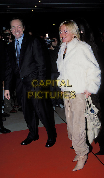 KEVIN SPACEY & GERI HALLIWELL.attends launch party for triggerstreet.com at the Sanderson Hotel..sales@capitalpictures.com.www.capitalpictures.com.©Capital Pictures.suede cropped combat trousers, boots, same outfit