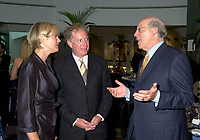 Astral Media CEO Ian Greenberg (R)) speak with Quebec opposition leader and chief of the Quebec Liberal Party ; Jean Charest (M) and his wife(L) at a private dinner, august 23rd , 200l in Montreal, CANADA.