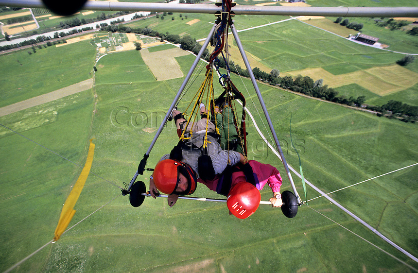 Tandem hang gliding over the countryside