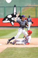 Everett AquaSox shortstop Christopher Taylor #17 attempts to turn a double play while the Spokane Indians' Nick Urbanus #7 slides into second base during a game at Everett Memorial Stadium on June 24, 2012 in Everett, WA.  Spokane defeated Everett 11-2.  (Ronnie Allen/Four Seam Images)