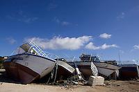 Cimitero delle barche...I barconi che trasportano i profughi vengono depositati in tre punti dell isola in attesa di essere smaltiti. ..Le barche depositate nei pressi del porto...Lampedusa 05 Marzo 2011...Photo Serena Cremaschi Insidefoto..........