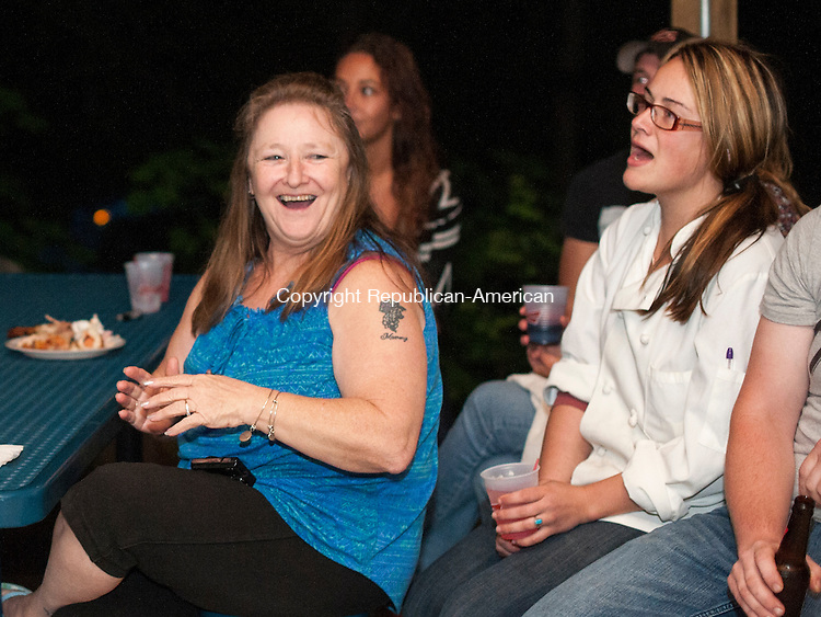 NEWTOWN, CT-19 May 2015-051915EC02-  Friends and family members of Sawyer Fredericks gathered to watch him perform in the finals of NBC's 'The Voice' at a viewing party Monday night at the VFW Post in Newtown. Grandmother Shirley Fredericks shares a laugh with Dakota Swiski. The 16-year-old singer lived in Newtown and Roxbury before moving to upstate New York. Erin Covey Republican-American