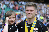 Owen Farrell of Saracens celebrates with his son after winning the Aviva Premiership Rugby Final between Saracens and Exeter Chiefs at Twickenham Stadium on Saturday 28th May 2016 (Photo: Rob Munro/Stewart Communications)