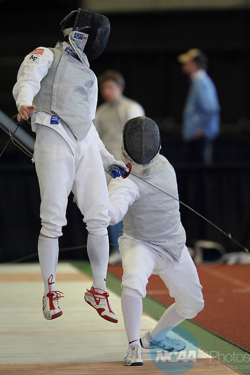 28 MAR 2010:  David Willette of Penn State forces Nicholas Stockdale of Air Force to go airborne during the Division I Men's Fencing Championship held at the Albert H. Gordon Indoor Track on the Harvard University campus in Cambridge, MA.  Willette defeated Stockdale 5-3 in a preliminary bout.  Damian Strohmeyer/NCAA Photos