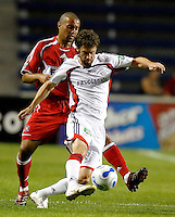New England Revolution forward Pat Noonan (11) makes a move in front of Chicago Fire defender Leonard Griffin (4).  The Chicago Fire defeated the New England Revolution 2-1 in the quarterfinals of the U.S. Open Cup at Toyota Park in Bridgeview, IL on August 23, 2006..