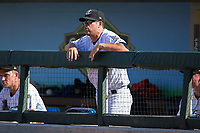 Charlotte Knights manager Mark Grudzielanek (15) watches the action from the dugout during the game against the Gwinnett Braves at BB&T BallPark on July 16, 2017 in Charlotte, North Carolina.  The Knights defeated the Braves 5-4.  (Brian Westerholt/Four Seam Images)