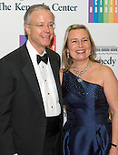 Donald J. Hall, Jr. and his wife arrive for the formal Artist's Dinner honoring the recipients of the 2013 Kennedy Center Honors hosted by United States Secretary of State John F. Kerry at the U.S. Department of State in Washington, D.C. on Saturday, December 7, 2013. The 2013 honorees are: opera singer Martina Arroyo; pianist,  keyboardist, bandleader and composer Herbie Hancock; pianist, singer and songwriter Billy Joel; actress Shirley MacLaine; and musician and songwriter Carlos Santana.<br /> Credit: Ron Sachs / CNP