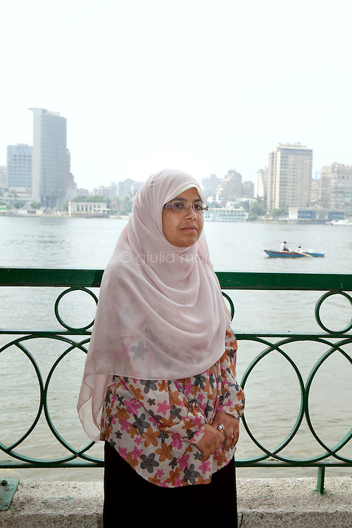 Nermeen Mohamed Hassan, 35 years old, teacher, poses at the Club for staff and teachers of the Cairo University in Manial area, along the Nile. Cairo, Egypt. October 2012.
