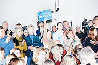 People listen as Vermont senator and Democratic presidential candidate Bernie Sanders speaks to senior citizens at the Peterborough Community Center gymnasium in Peterborough, New Hampshire.