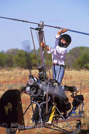 Barbara Brown, jillaroo starting up her gyrocopter. Bundarra Station, outback New South Wales