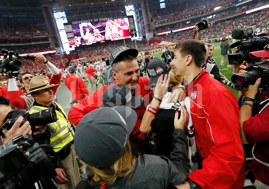 Ohio State Buckeyes head coach Urban Meyer hugs his family following Ohio State's 44-28 win over the Notre Dame Fighting Irish in the Battlefrog Fiesta Bowl at University of Phoenix Stadium in Glendale, Arizona on Jan. 1, 2016. (Adam Cairns / The Columbus Dispatch)