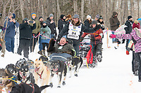 Jessie Holmes and team run past spectators on the bike/ski trail near University Lake with an Iditarider in the basket and a handler during the Anchorage, Alaska ceremonial start on Saturday, March 7 during the 2020 Iditarod race. Photo © 2020 by Ed Bennett/Bennett Images LLC