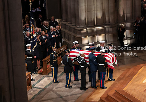December 5, 2018 - Washington, DC, United States: The casket of former President George W. Bush arrives at the National Cathedral where a state funeral is held in his honor. <br /> Credit: Chris Kleponis / Pool via CNP