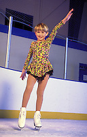 Young  girl ice skater shows style