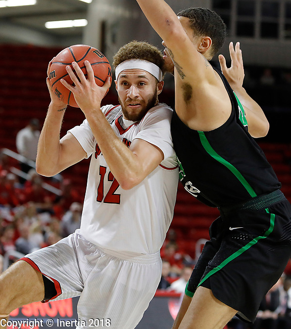 VERMILLION, SD: MARCH 14:  Trey  Burch-Manning #12 of South Dakota drives past Zachary Simmons #24 of North Texas during the 2018 CBI Basketball Tournament at the Sanford Coyote Sports Center in Vermillion, S.D.  (Photo by DIck Carlson/Inertia)