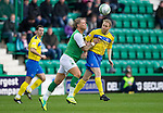 Hibs v St Johnstone...21.01.12.Steven Anderson clears from Gary O'Connor.Picture by Graeme Hart..Copyright Perthshire Picture Agency.Tel: 01738 623350  Mobile: 07990 594431
