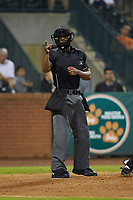 Home plate umpire Harley Acosta makes a strike call during the South Atlantic League game between the West Virginia Power and the Greensboro Grasshoppers at First National Bank Field on June 1, 2018 in Greensboro, North Carolina. The Grasshoppers defeated the Power 10-3. (Brian Westerholt/Four Seam Images)