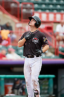 Erie SeaWolves catcher Jake Rogers (7) puts his hand over his heart and looks skyward after hitting a home run in the bottom of the fourth inning during a game against the New Hampshire Fisher Cats on June 20, 2018 at UPMC Park in Erie, Pennsylvania.  New Hampshire defeated Erie 10-9.  (Mike Janes/Four Seam Images)